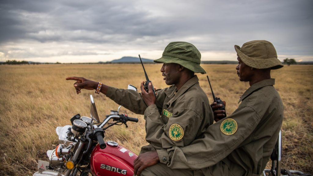Makame rangers on motorbike
